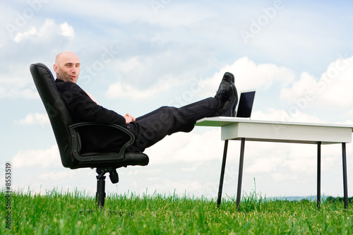 Business man outside in chair