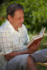 Aged man reading book