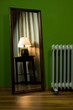 Green room with lamp in mirror and radiator