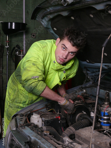 station of carservice worker looking in camera