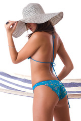 Sexy girl wearing bikini with summer hat