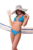 Attractive girlwearing bikini with summer hat