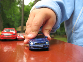 Little boy play with toy-car, detail hand and toy