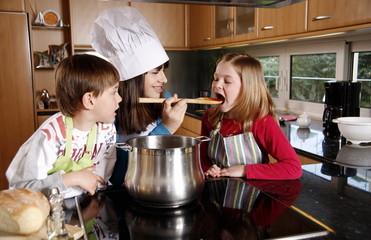Children cooking spaghetti