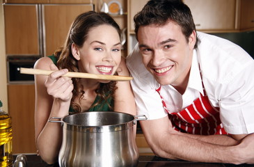 A couple cooking together