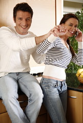 A young couple in the kitchen