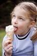 Young girl eating ice cream