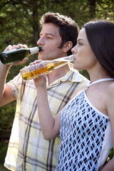 Young couple drinking beer
