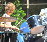 Young jazz drummer performing in public. poster