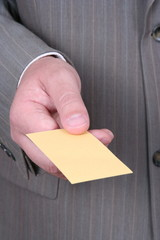 Hand of businessman offering business card
