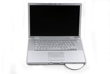 Laptop isolated with CD