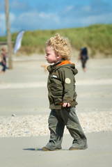 boy walking on the beach