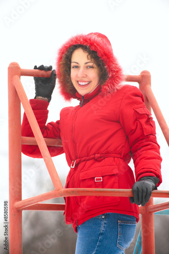pretty woman on metallic ladder in winter