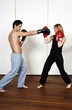 Straight right-hand punch of Active Tae Bo and inside block