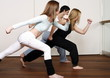 Students learning a basic Capoeira move
