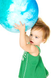 Cute toddler holding a big Ggobe over her head