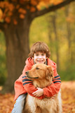 Boy Hugging Dog in the Fall