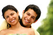 Young Couple Smiling & Hugging  Portrait