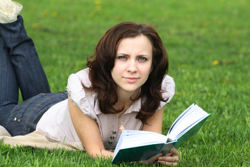 girl with the book on the nature