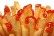 French fries drizzled with ketchup