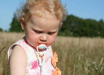 girl on meadow with teat