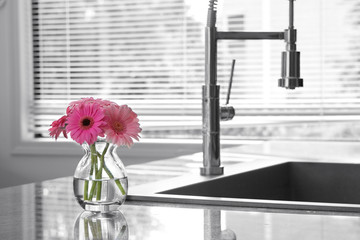 vase of flowers & a kitchen sink