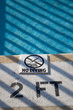 "A ""no diving"" sign on a pool deck"