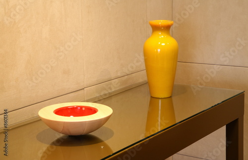 Sidetable with decorative vase and bowl