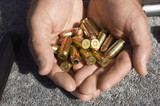 Mans hands holding bullets, close-up