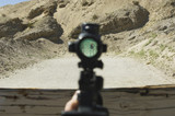 Rifle sight aiming at target on firing range