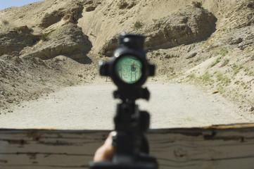 Rifle sight aiming at target on firing range