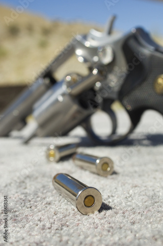 Bullets beside gun, close-up
