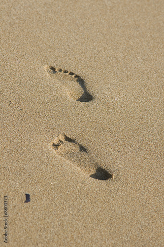 Foot prints on the wet sand