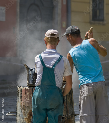 Men Working with Hot Tar