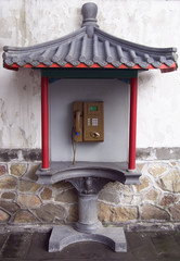 Public telephone box in chinese style.