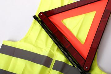warning triangle and yellow waistcoat