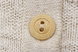 wooden button on knitwear poster