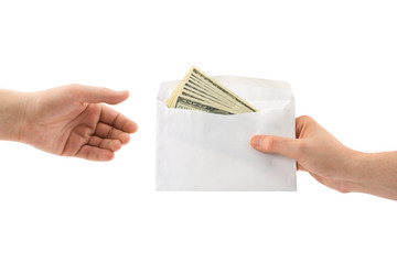 Hands and money in envelope