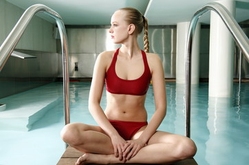 Young woman  in a swimming pool at a spa