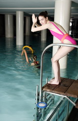 Young woman ready  to jump in the pool