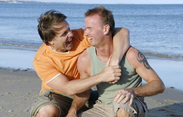 Happy gay couple on beach