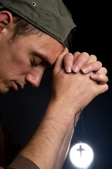 Praying Man Holding A Cross -2