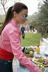 Young woman at barbecue