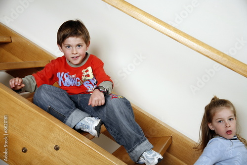 Tired children on staircase