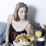 beautiful caucasian women havin her breakfast serve on on tray poster