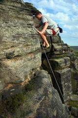 Climbing a rock face