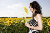girl in field with sunflower
