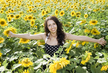 smiling happy girl in field of sunflowers