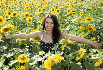 smiling girl in field of sunflowers
