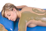 Woman having seaweed body treatment applied poster